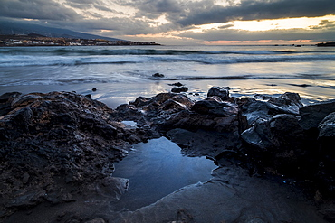 Rocks on beach at sunset in Tenerife, Spain