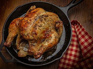 Roast chicken in frying pan