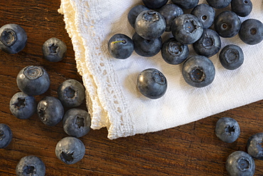 Blueberries on white fabric