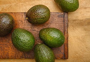 Avocados on cutting board