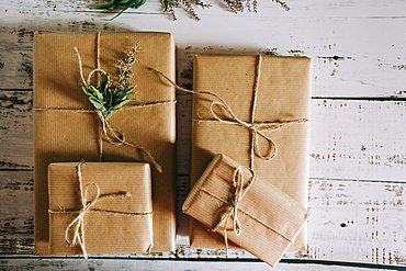 Presents wrapped in brown paper and string with flowers