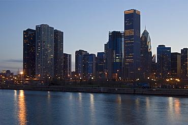 Skyline at night with Lake Michigan Chicago Illinois USA
