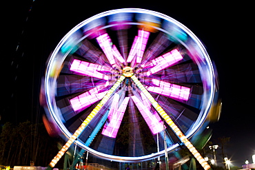 Blurred image of Ferris wheel at night at Santa's Enchanted Forest in Miami, Florida, United States of America