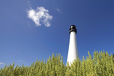 White lighthouse against sky in Key Biscayne, Florida, United States of America