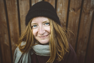 Portrait of smiling young woman wearing woolly hat