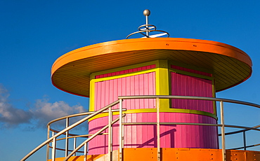 Pink and orange beach hut against sky in Miami, Florida, United States of America
