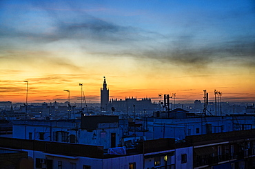 Cityscape with Seville Cathedral at sunrise in Seville, Andalusia, Spain