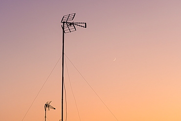 Silhouette of antenna at sunset in Seville, Andalusia, Spain