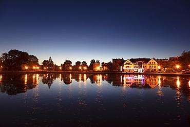 Lake and street lights at sunset in Mragowo, Warmian-Masurian, Poland