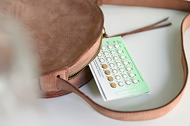 Birth control next to purse