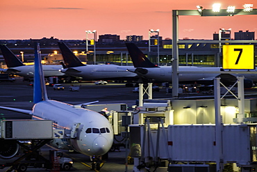 Airplane at airport terminal