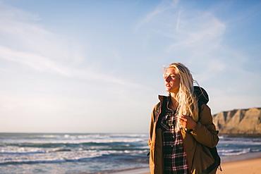 Woman wearing jacket at beach