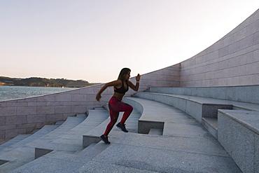 Woman running up steps, Lisboa, Lisbon, Portugal