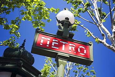 Low angle view of Metro sign on lamp post