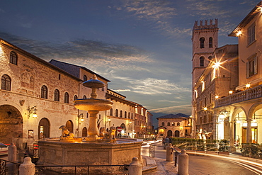 Fountain in Piazza del Comune at sunset in Assisi, Italy