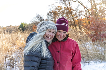 Smiling women wearing winter clothing, Mount Horeb, Wisconsin, USA