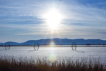 Wheels in snowy field, Bellevue, Idaho, USA