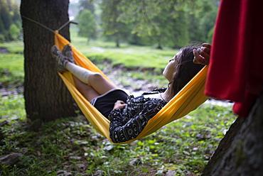 Woman lying in hammock in Appenzell, Switzerland