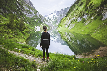 Woman by mountains and lake in Appenzell, Switzerland