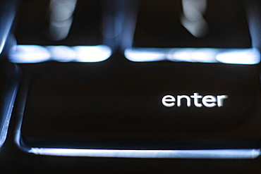 Illuminated 'enter' key on keyboard