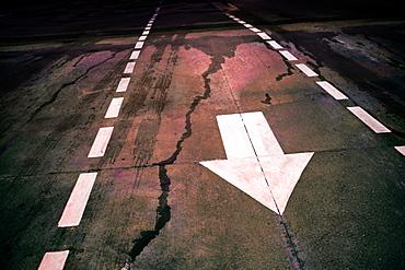 White arrow on wet road