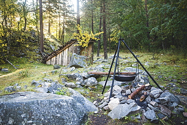 Cooking pot on tripod above campfire