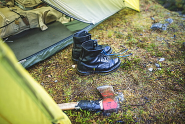 Boots and hatchet by tent