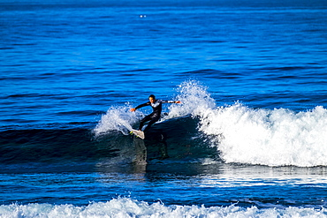 Teenage boy surfing waves