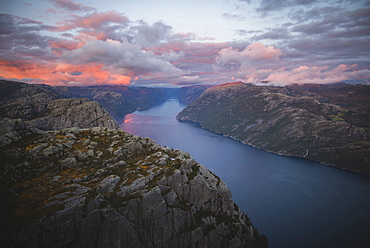 Preikestolen cliff by Lysefjord at sunset in Rogaland, Norway