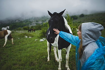 Woman petting Icelandic horse