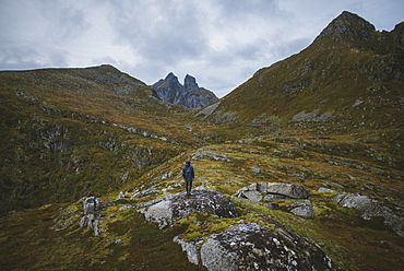 Man standing on mountain in Lofoten Islands, Norway