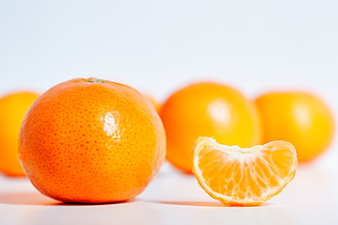 Mandarins against white background