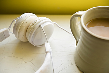 White headphones and cup of coffee