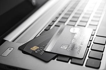 Credit cards on laptop keyboard