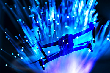Double exposure of drone and fibre optic cables