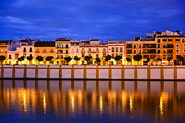 Spain, Seville, Triana, Triana neighborhood reflecting in Guadalquivir River