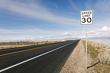 USA, Utah, Salt Lake City, Empty road with speed limit sign