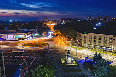 Moldova, Chisinau, Cityscape illuminated at dusk