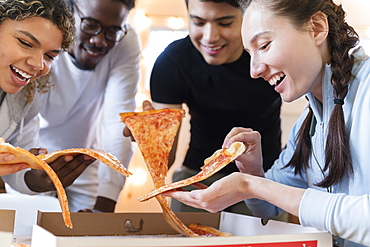 Group of friends having pizza together