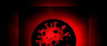 Model of Coronavirus in against black and red background