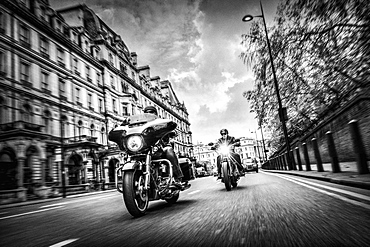 United Kingdom, London, Motorcyclists on city street