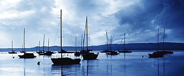 USA, Michigan, Sailboats in harbor at stormy day