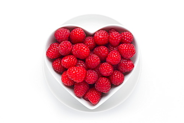 Raspberries in heart-shaped bowl