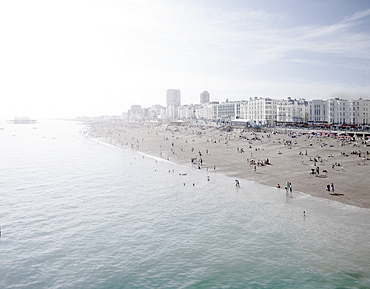 United Kingdom, England, Brighton, People resting at urban beach