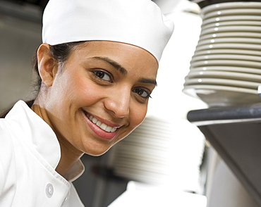 Female chef in restaurant kitchen