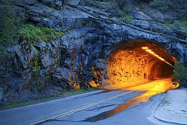 Illuminated tunnel in mountains