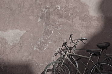 Morocco, Marrakesh, Two bicycles next to old wall