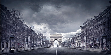 France, Paris, Triumphal arch at end of shopping street