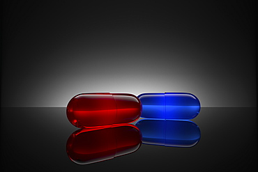 Studio shot of red and blue pills