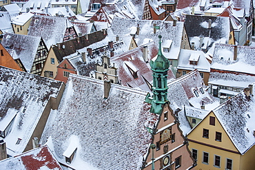 Germany, Rothenberg au Tauber, Roofs of old town buildings in snow